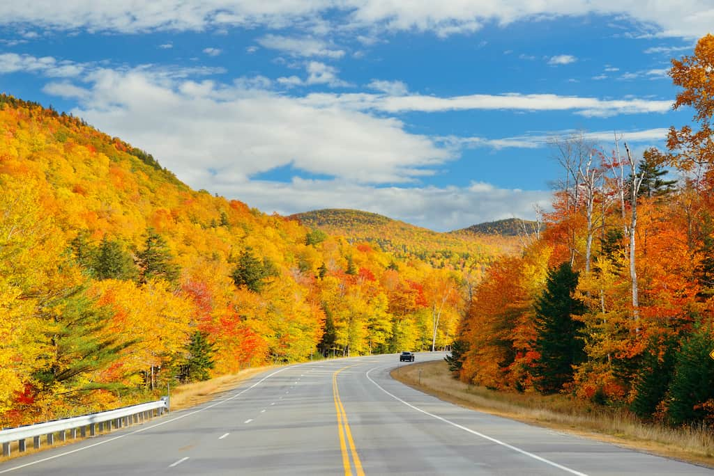 Fall foliage along a stretch of highway in Vermont.