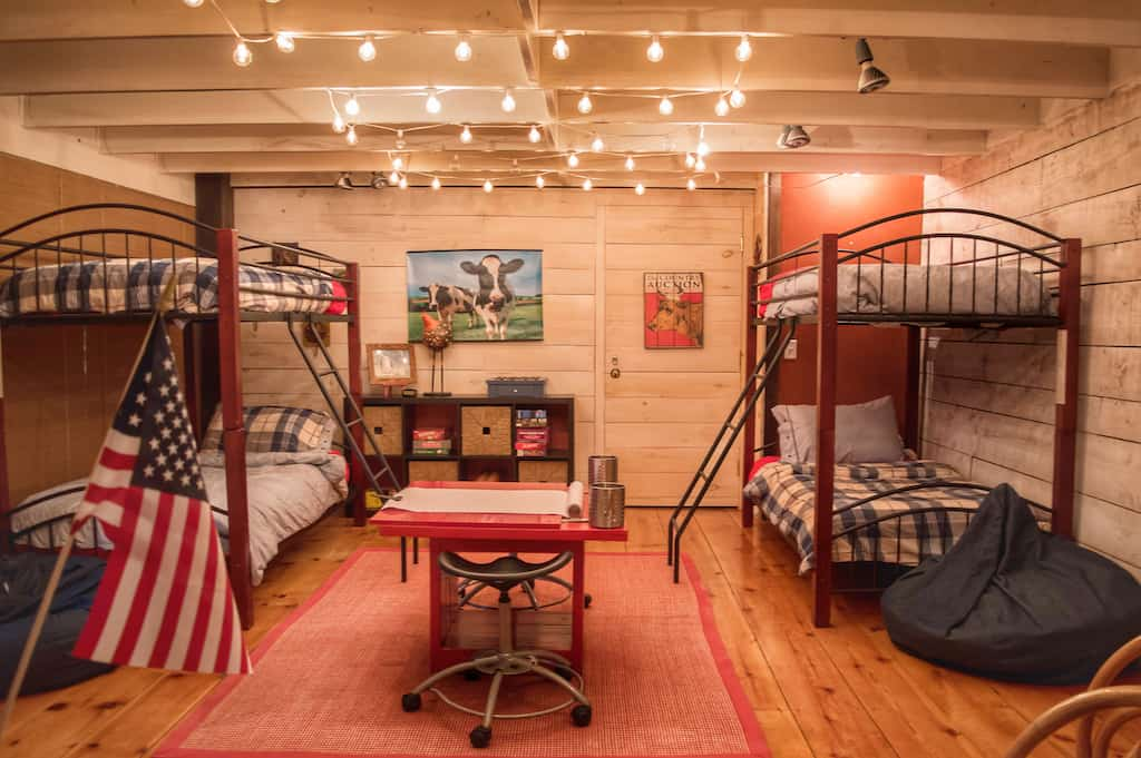 An interior shot featuring two sets of bunk beds surrounded by twinkling lights