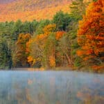 Fall foliage surrounding Lake Shaftsbury in Vermont.