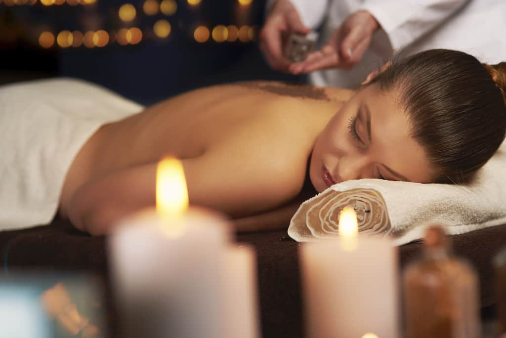 A moman relaxes during a massage at a Vermont spa weekend.