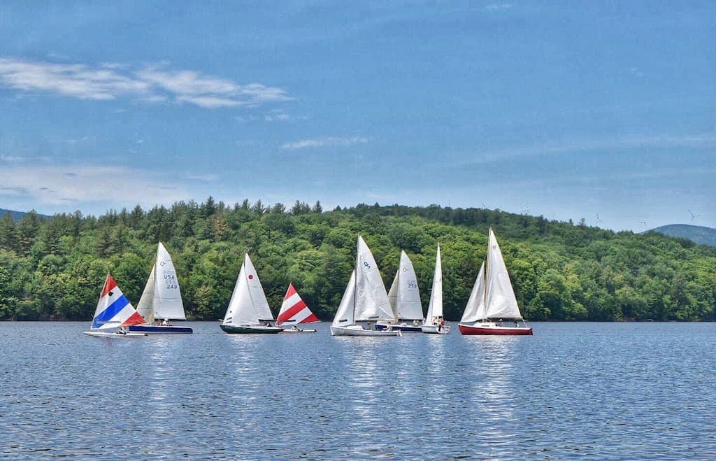 A dozen sailboats congregating on Lake Whitingham in Wilmington, VT