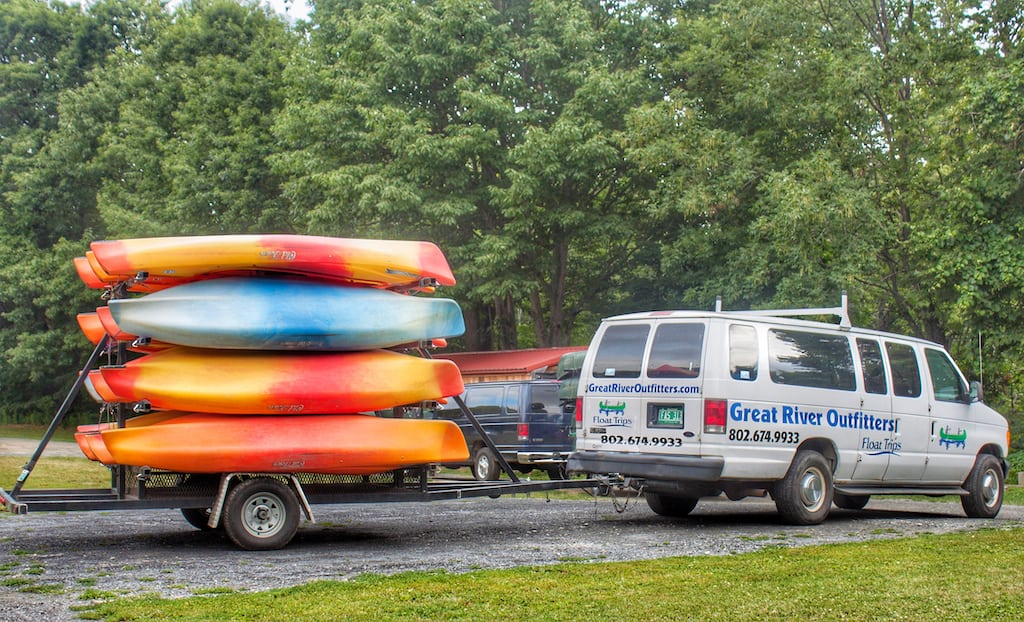 The kayak and canoe transport vehicle for Great River Outfitters.