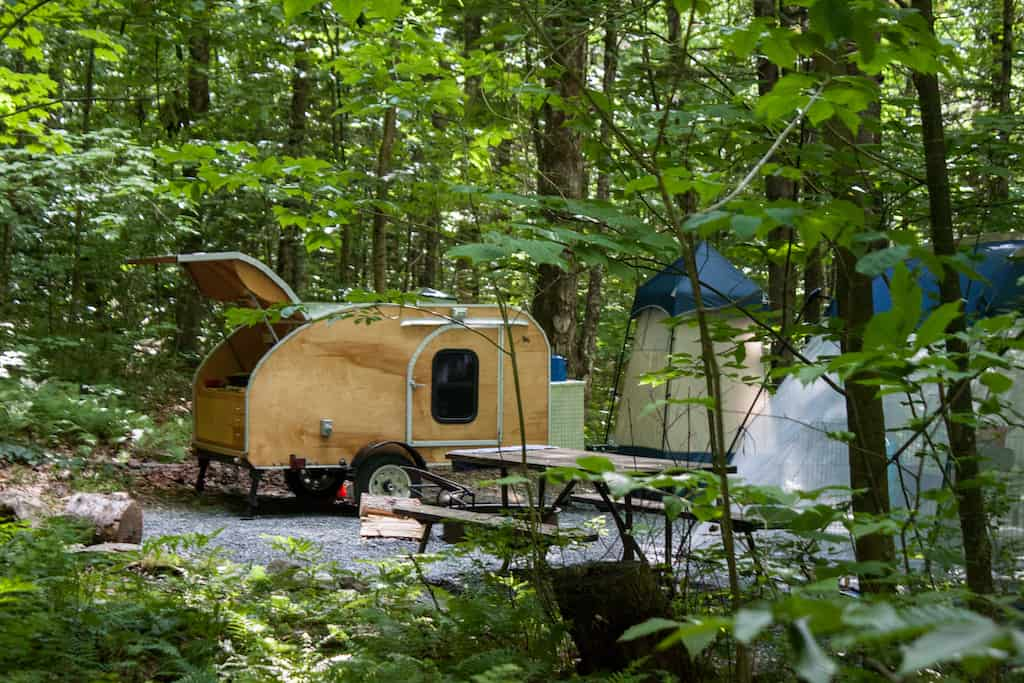 A small teardrop camper in Molly Stark State Park.