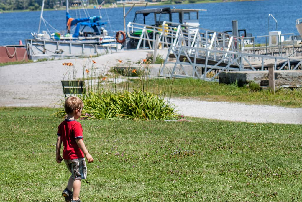 A child walking down to the water at Burton Island Marina in Vermont.
