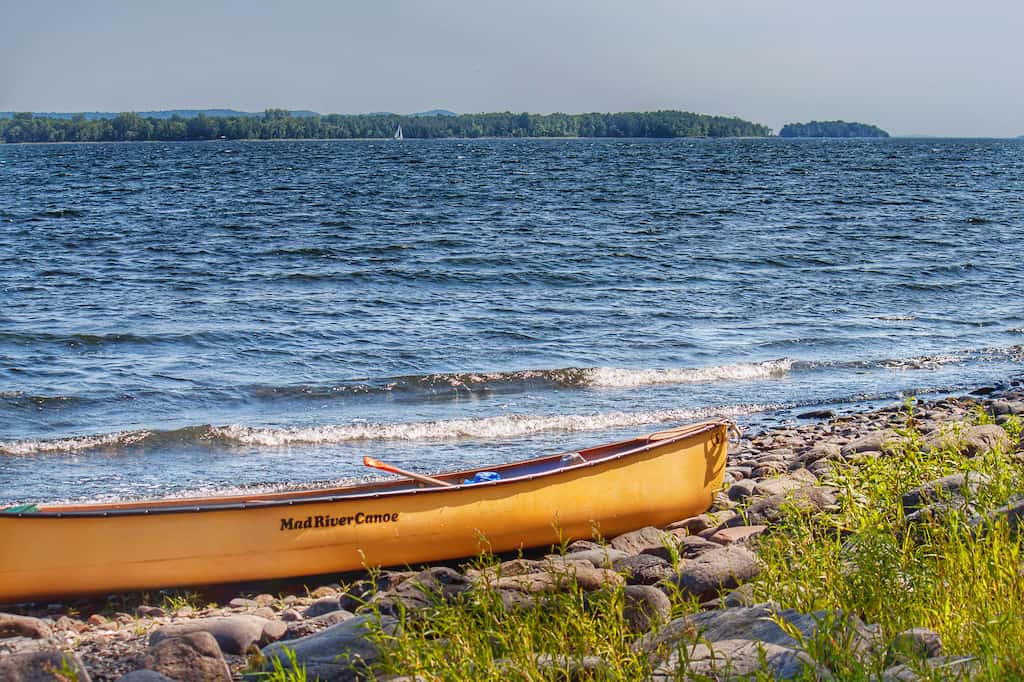 Our Mad River Canoe on the shore of Woods Island in Vermont.