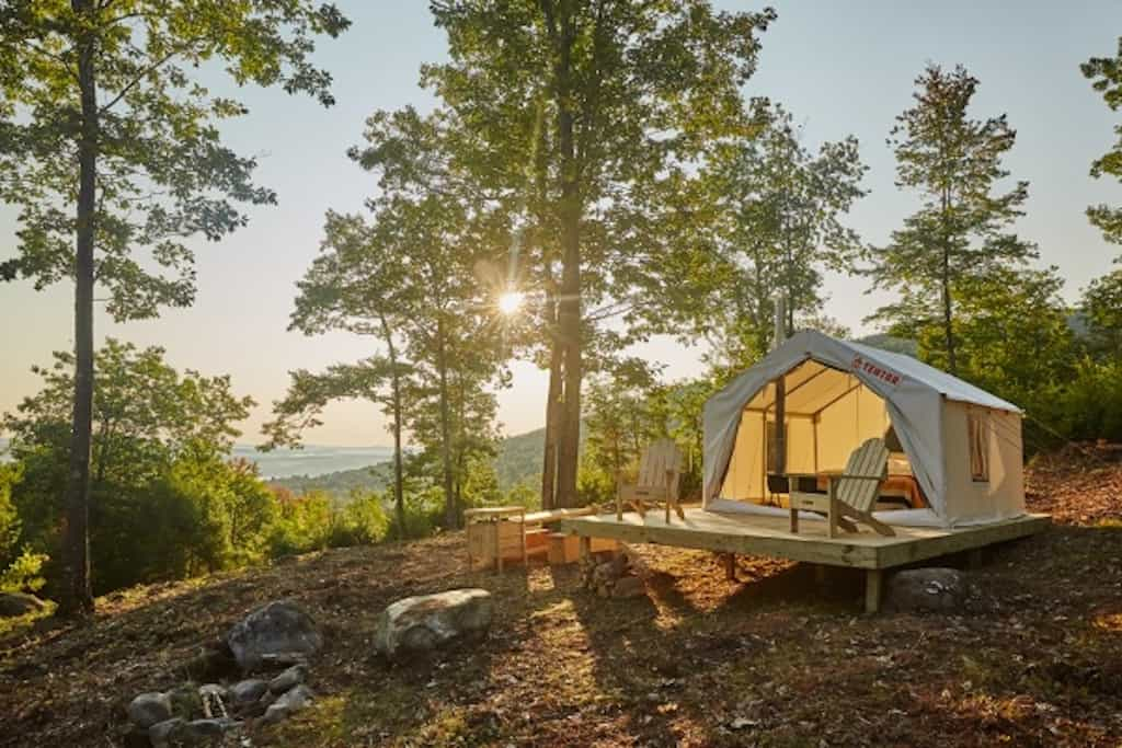 A Tentrr glamping site in the woods with mountain views.