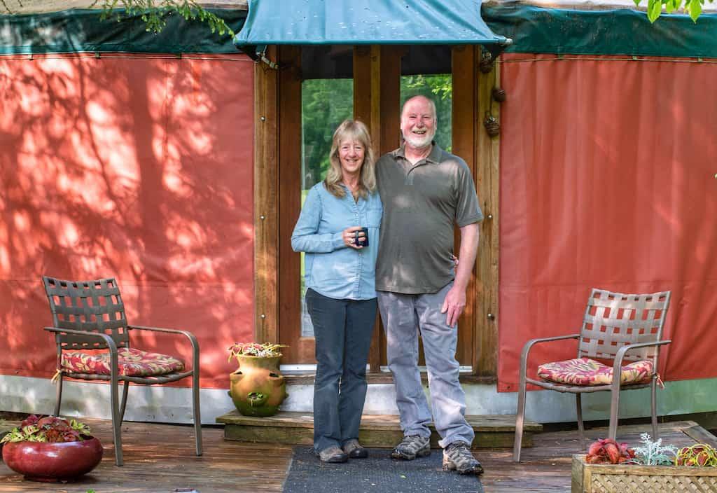 Hosts Ellen and Jay in front of their yurt rental in New Haven, Vermont.