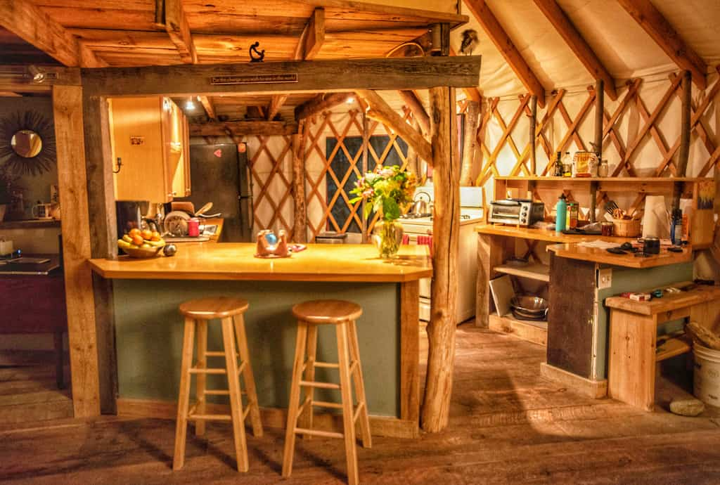 The kitchen inside a yurt for rent in Bristol, Vermont.