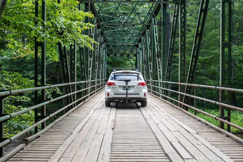 A car driving over the bridge that leads to Jamaica State Park in Vermont.