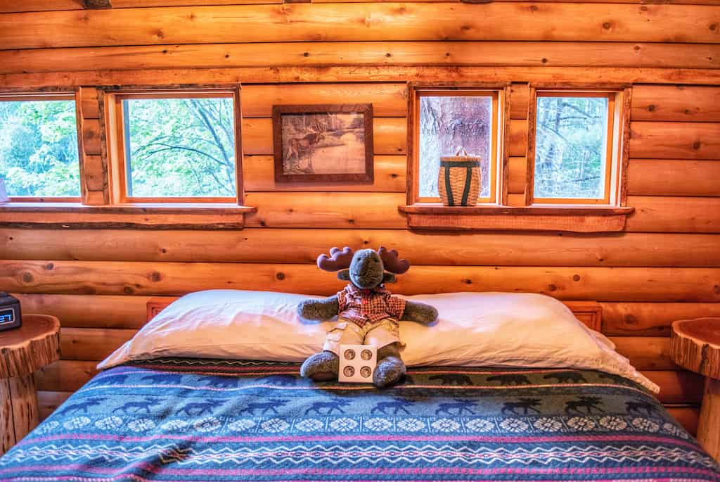 The queen-size bed in Moose Meadow Treehouse in Waterbury, Vermont.