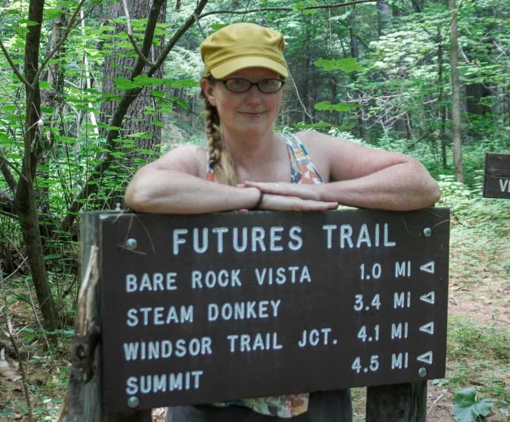 Me, posing with a trail sign at the Futures Trailhead in Mount Ascutney State Park.