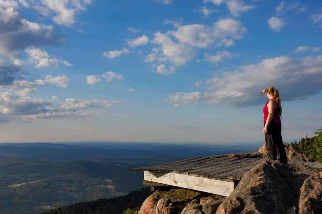 A hiker checks out the view from the hang gliding platform on the top of Mt. Ascutney in Vermont.