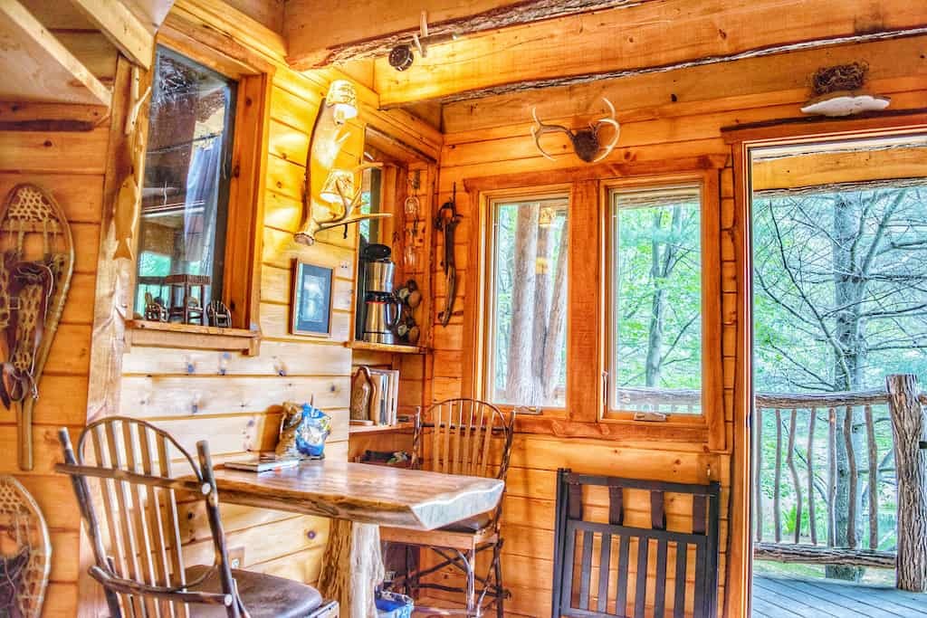 The interior dining area at Moose Meadow Treehouse in Waterbury, Vermont.