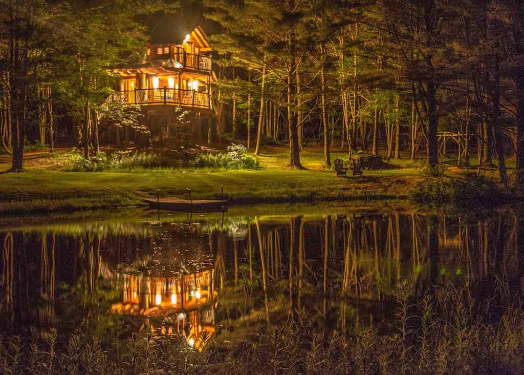 A night time view of Moose Meadow Treehouse near Waterbury, Vermont