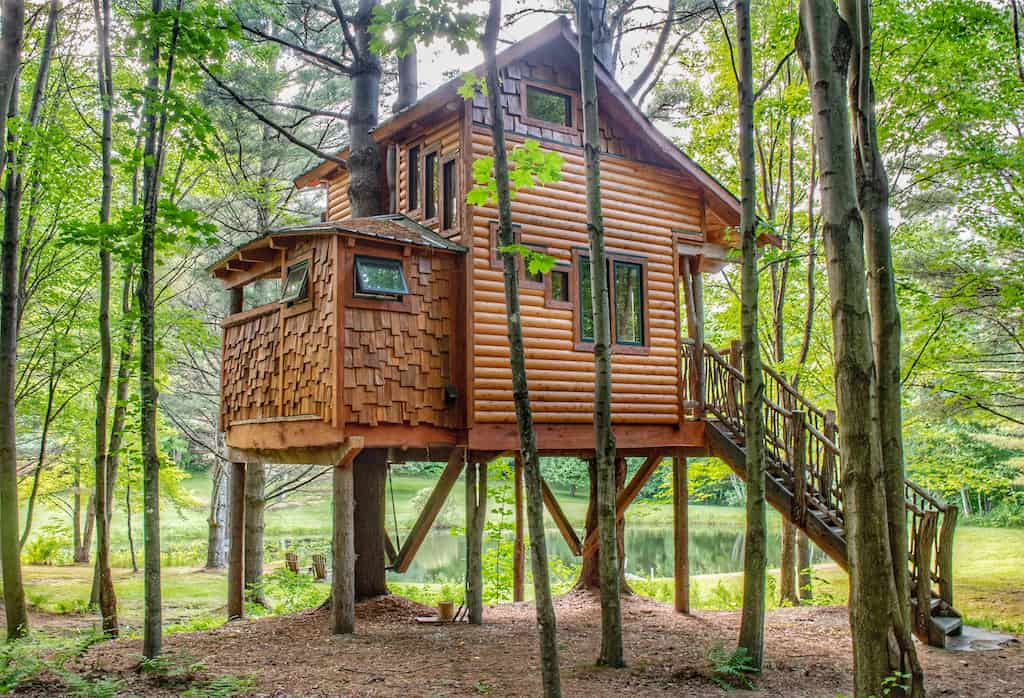 The back view of Moose Meadow Treehouse rental in Waterbury, Vermont.