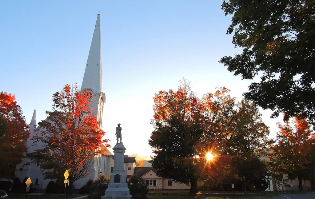 Sunrise over the church steeple in Manchester Village, Vermont in the fall.