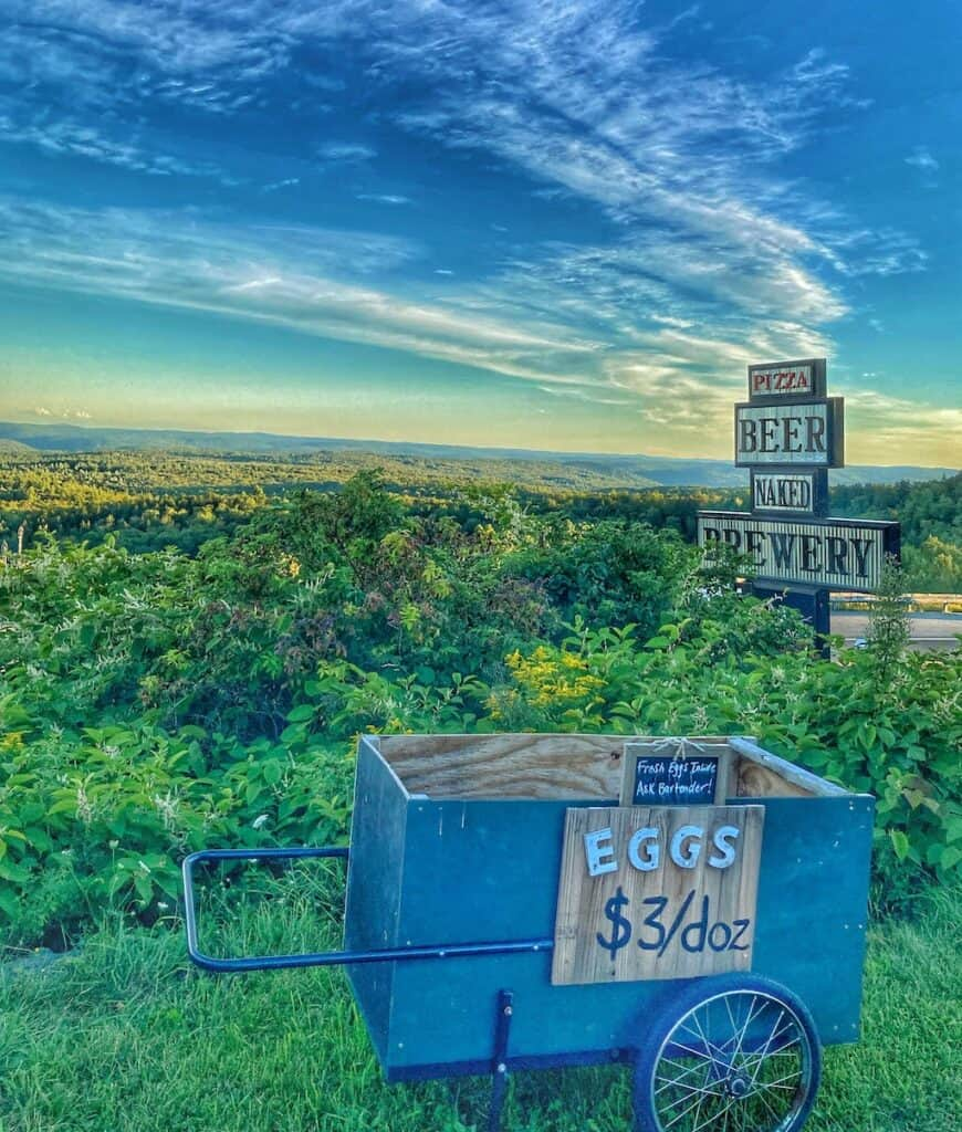 A sign advertising eggs for $3, plus beer and pizza at the top of Hogback Mountain in Wilmington, Vermont.