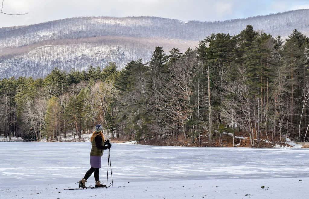 Snowshoeing across frozen Lake Shaftsbury in Vermont.