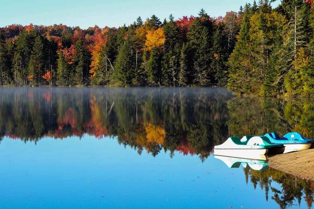 Fall foliage view on the lake in Woodford, Vermont.