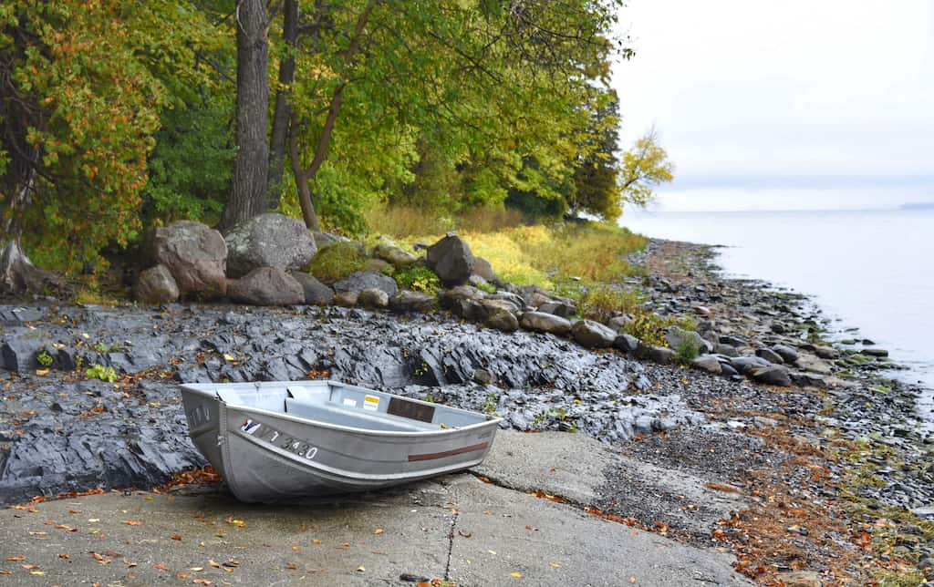 A rowboat beached on the shore of Grand Isle State Park in South Hero, Vermont.